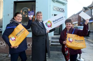 Winners of the Ballymena Means 'Discount Day' social media competition for two vouchers worth £100 are Linda Lowry (left) and Catherine Moore (right), pictured with BID Chairman, Clive Kyle.