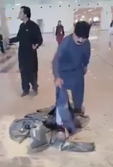 Man sets luggage on fire.