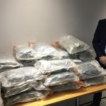 Detective Superintendent Bobby Singleton with approximately 50kg of herbal cannabis with an estimated street value of just under £1million following a proactive operation in Belfast yesterday