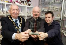Chair of Mid Ulster District Council, Councillor Sean McPeake is pictured with Nigel and Scott Patterson from Pattersons Shoes Dungannon and their Rainbow Club Irish Retailer of the Year award.